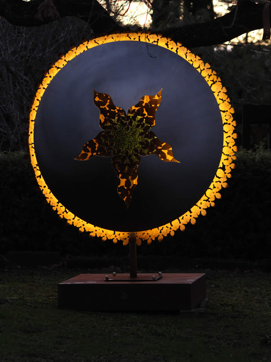 1.7m diameter, stainless steel, corten steel, LED and a tuft of faux turf, also available as wall hung