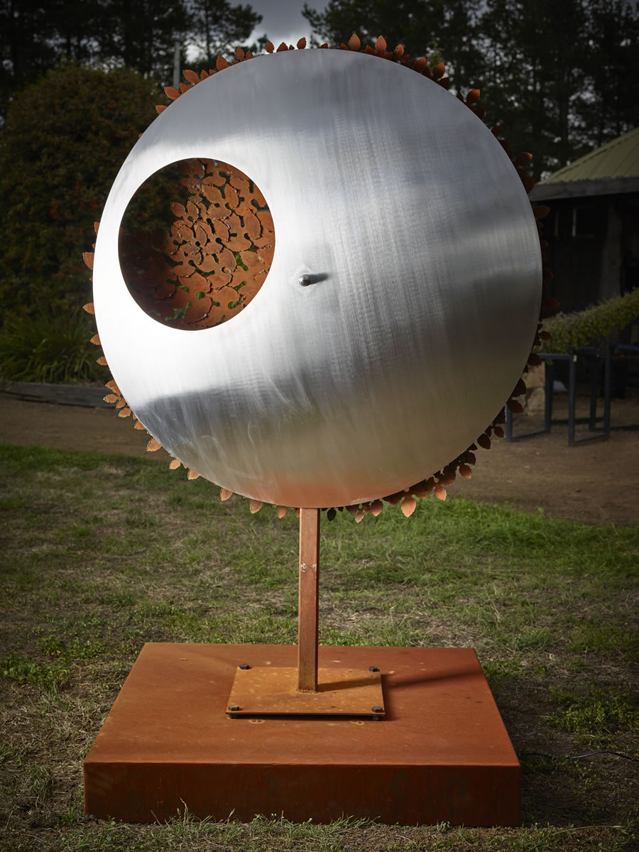 1.2m diameter, 2m tall, two sided corten/stainless steel with exterior LED lighting (side 1)